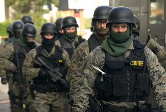 SWAT team in riot gear