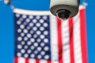 Security camera with American flag in background