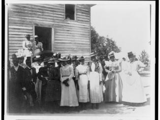 African Americans posed outside of church