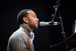 John Legend performing on piano