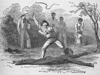 Flogging a slave fastened to the ground